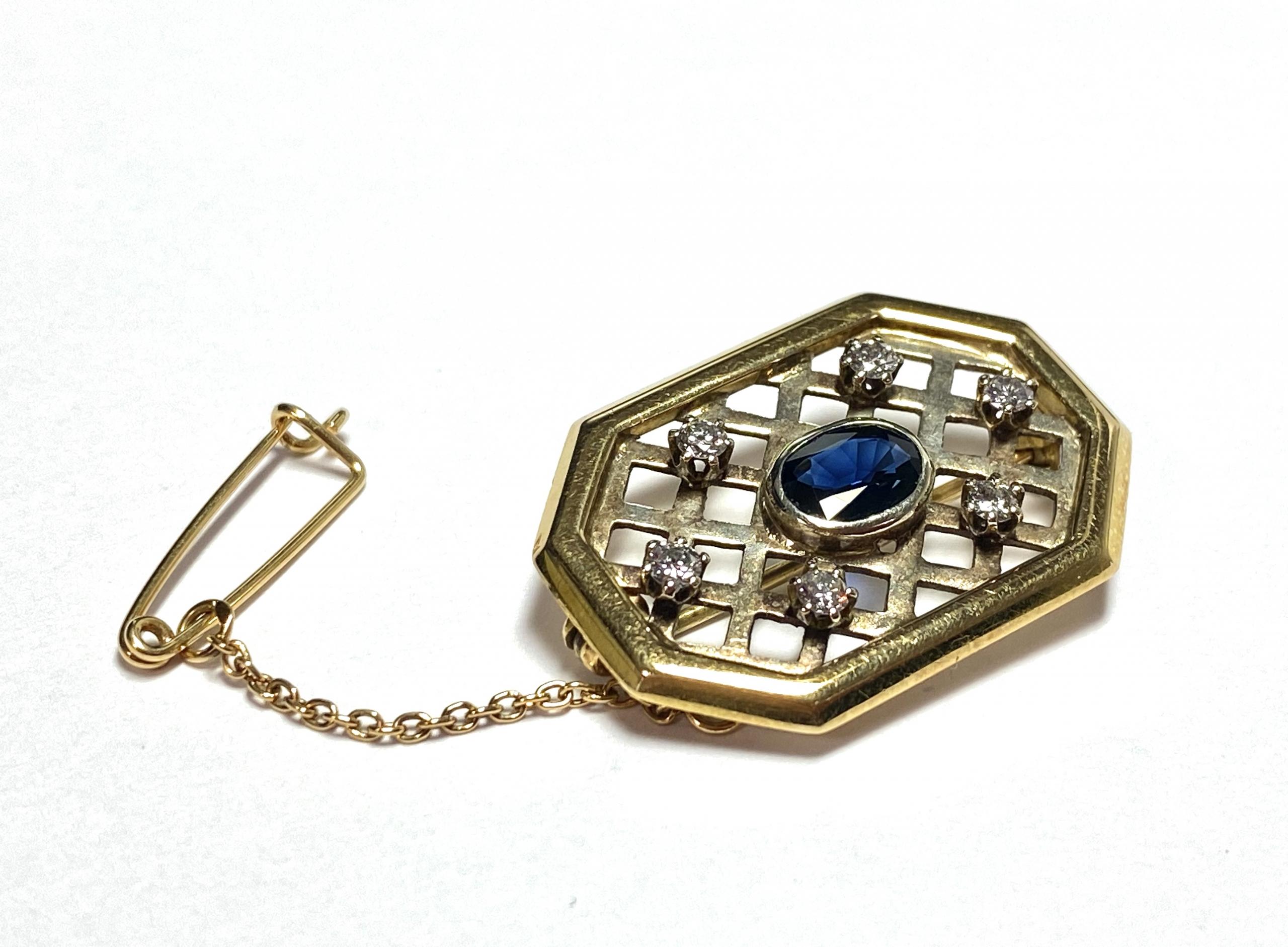 [写真]サファイア、ダイヤモンドのブローチ